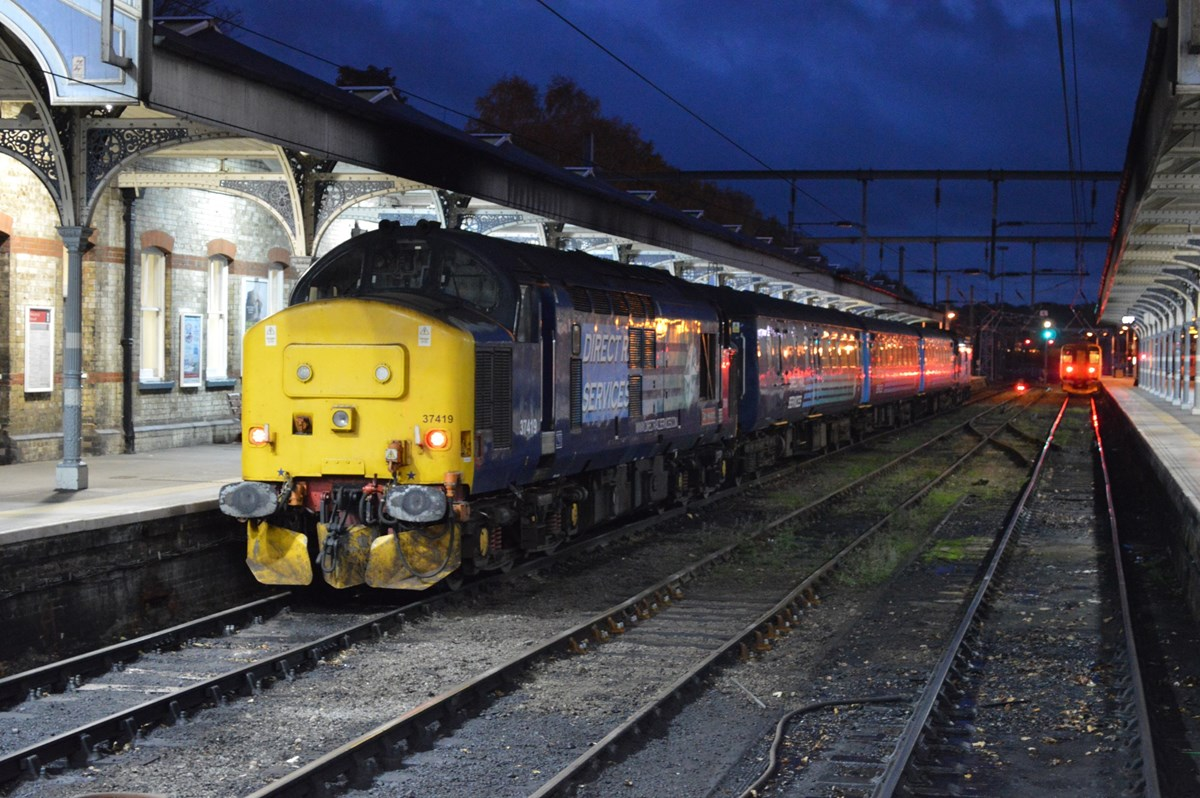 DRS 37419 waits to trail the 1736 to Great Yarmouth from Norwich on November 12. The Class 37 at each end of the train is powered, meaning there is more than 3,000hp available to haul three coaches.