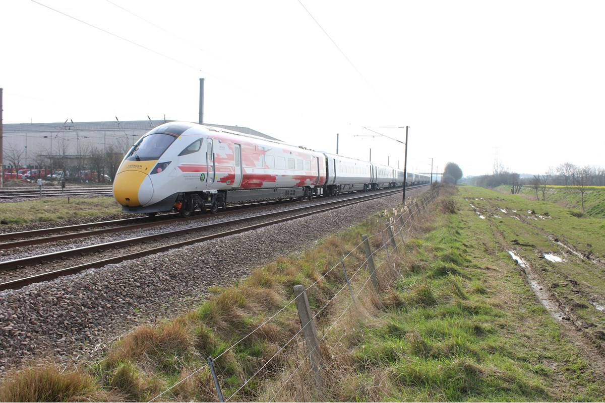 800002 trails 800001 through Marholm, near Peterborough, on April 11, with the 0836 Old Dalby-North Pole. The '800' carries Virgin Trains branding from the official opening of the Newton Aycliffe facility last September. ANDREW WRIGHT.