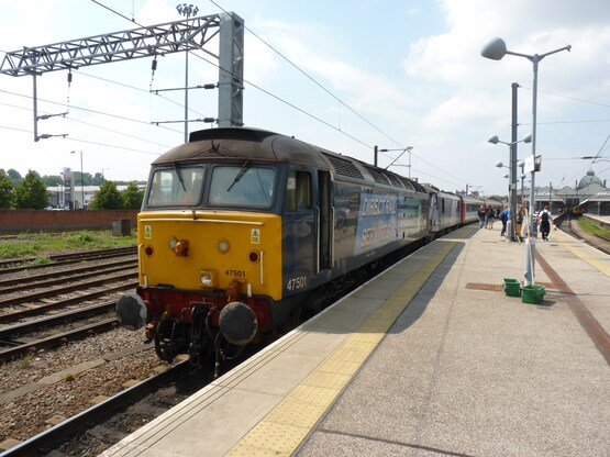 Direct Rail Services 47501 Craftsman stands at Norwich on July 12 2014, with the 1230 London Liverpool Street-Great Yarmouth. The '47' is now owned by Locomotive Services Ltd. RICHARD CLINNICK.