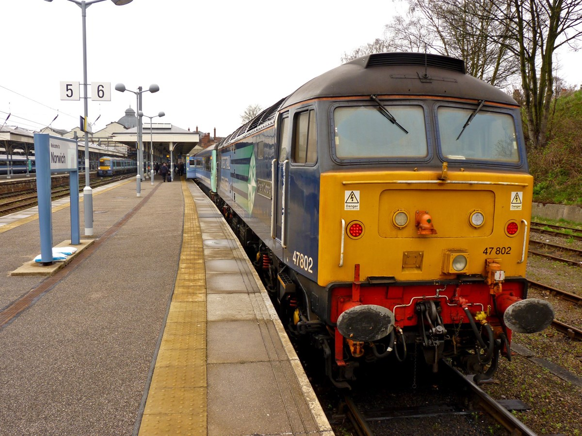 One of the original four Direct Rail Services Class 47s, 47802 Pride of Cumbria stands at Norwich on April 17 2014, with the 1036 to Great Yarmouth. The '47' is now part of the West Coast Railway fleet. RICHARD CLINNICK.