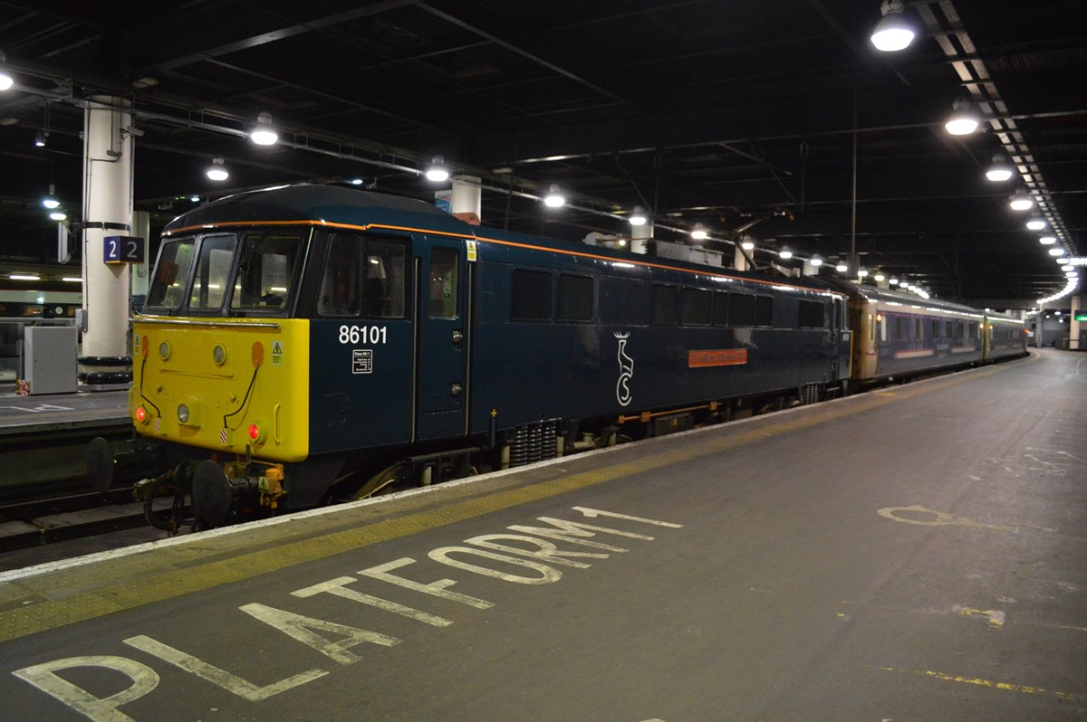 On January 18, Caledonian Sleeper 86101 Sir William A Stanier FRS stands at London Euston with empty coaching stock from Wembley that will form the 2350 to Glasgow Central. RICHARD CLINNICK.