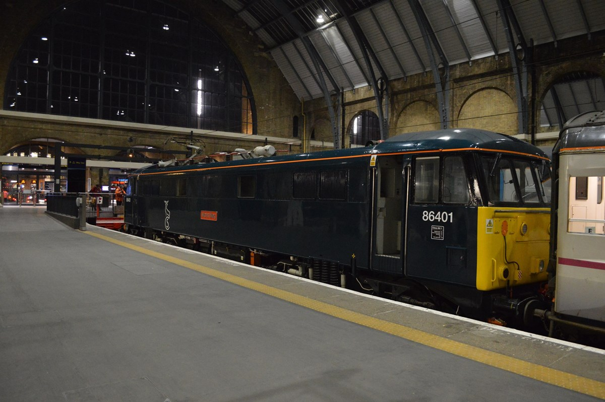 Caledonian Sleeper 86401 Mons Meg stands at London King's Cross on January 18, with the empty coaching stock from Wembley that forms the 2106 Highland Sleeper to Aberdeen/Fort William/Inverness.