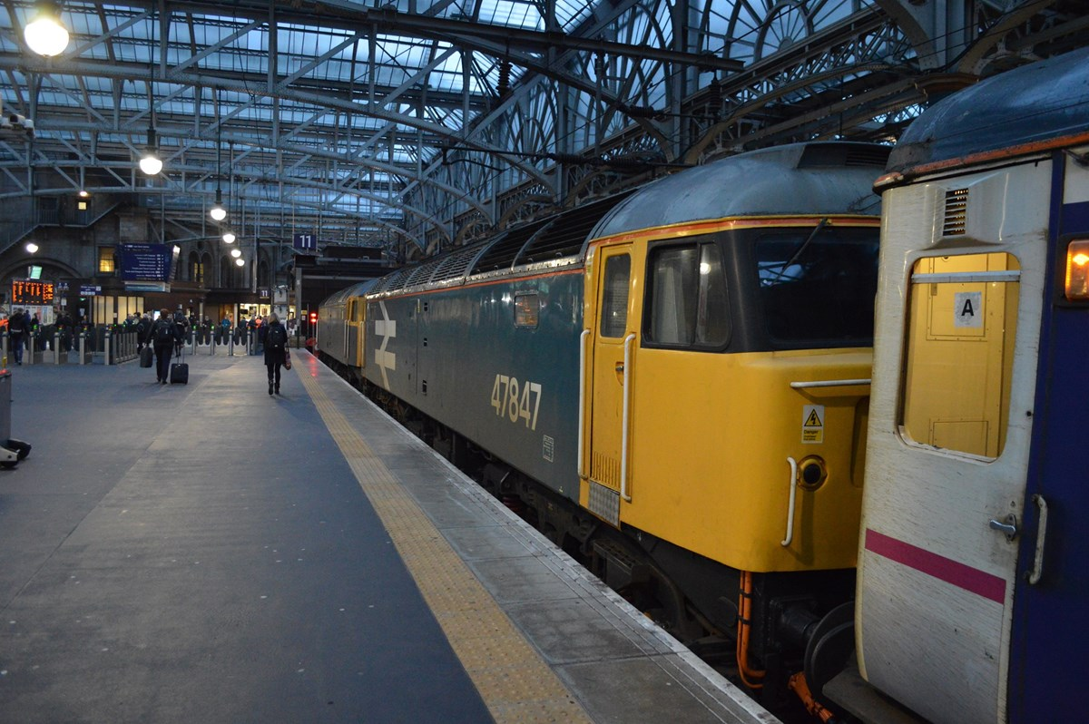 Large logo blue 47847 stands at Glasgow Central on January 19, with the 2350 from London Euston. Paired with 47812, the '47/8' hauled Caledonian Sleeper's train via Dumfries, replacing 90048 at Carlisle. RICHARD CLINNICK.