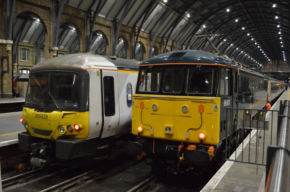 Govia Thameslink Railway 365523 is a more common visitor to London King's Cross on January 18, as Caledonian Sleeper 86401 Mons Meg stands under the train shed having hauled empty coaching stock from Wembley ready for that night's 2106 to Aberdeen/Fort William/Inverness. RICHARD CLINNICK.