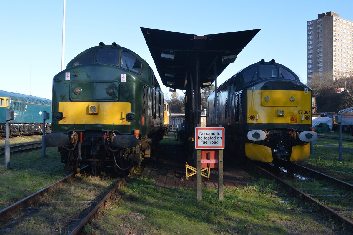 UK Rail Leasing 37905 (left) and Europhoenix 37884 (right) stand at the Leicester depot fuelling point on January 15. RICHARD CLINNICK.