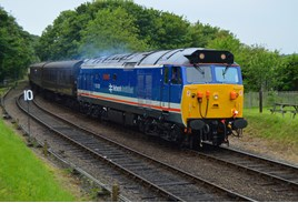 50026 Indomitable approaches Weybourne on June 10. DARREN FORD.