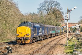 Controlled by soon-to-be-replaced Victorian mechanical signalling, 37407 and (nearest the camera) 37423 accelerate Greater Anglia's 1455 Norwich-Lowestoft away from Reedham on April 18. GLEN BATTEN.