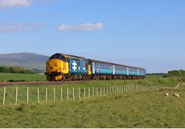 Northern's 1731 Barrow-Carlisle, hauled by DRS 37402, passes Black Combe Fell on June 2. TOM MCATEE.