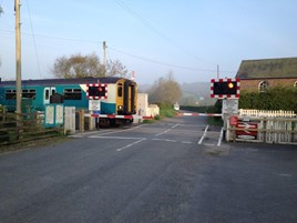 Dolau (Wales) level crossing. Previously open now fitted with barriers. NETWORK RAIL.