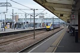Hull Trains 180111 races through Peterborough on July 6. RICHARD CLINNICK.