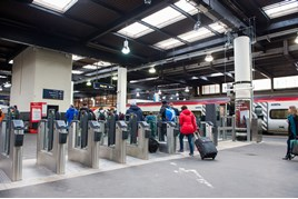 Passengers pass through a ticket barrier at London Euston on December 1. JACK BOSKETT/RAIL.