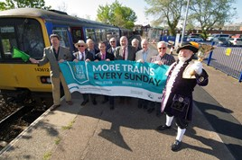 Councillor Andrew Leadbetter (left) waves off the new Sunday service with Deputy Mayor for Exmouth Brian Cole, GWR Driver Competence Manager Paul Samways, Driver Competence Manager and chairman of Avocet Line Rail Users' Group Mike Reddaway, ALRUG Committee members, and Exmouth Town Crier Roger Bourgein. GWR.