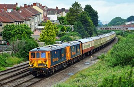 GB Railfreight 73961 and 73964 approach Parson Street, near Bristol, with the Ashford International-Weston Super Mare private charter for GB Railfreight staff on June 18. The train is formed of Mk 1 coaches. MARK PIKE.