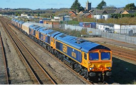 GBRf 66708 Jayne hauls 66777/776/779/778/773/774/775 through Severn Beach, with the 1045 Newport Docks-Doncaster Roberts Road, the very last new Class 66 convoy. MARK PIKE.