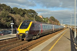 Recently reformed CrossCountry 221144 departs Dawlish on January 26 with the 1404 Paignton-Manchester Piccadilly. 100 metres of the sea wall collapsed just beyond the station, and now almost four years later the Government is being accused of gambling with the region's economy due to the lack of a permanent solution to the railway's resilience. DAVID HUNT.