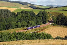 ScotRail 158741 heads out from Bowshank Tunnel on August 10, with the 0753 Edinburgh Waverley-Tweedbank.  PHIL METCALFE.