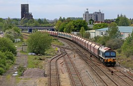 On May 19, 59101 Village of Chantry hauls the 1142 Merehead Quarry-Theale aggregates train through Newbury Racecourse. Operated by DB Cargo, the train includes former coal hoppers displaced following the collapse of that sector. The amount of coal carried by rail is at its lowest since 1984-1985. KEN BRUNT.