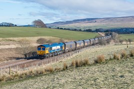 GB Railfreight 66709 Sorrento hauls a loaded coal train north of Bank Junction, near New Cumnock on March 15, with the 1515 Greenburn-Drax Power station. DONALD CAMERON.