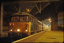Preserved 87002 Royal Sovereign stands at Liverpool Lime Street on March 12, with empty coaching stock for a football special that ran from Liverpool South Parkway to London Euston. CHRIS WILLIAMS.