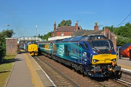 On July 4, Direct Rail Services 68023 Achilles stands at Acle with the 0902 Norwich-Great Yarmouth training run. On the rear was 68016 Fearless. On the left is DRS 37405, which is trailing Abellio Greater Anglia's 0917 Great Yarmouth-Norwich, led by 37422. AGA hires the '68s' from DRS to cover for an unavailable Class 170. STEVE POTTER.
