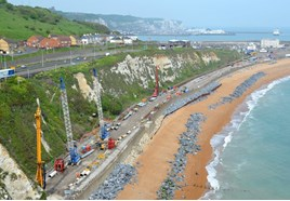 More than 25,000 tonnes of rock armour has been delivered from Norway by barge to Shakespeare Beach, near Dover. This is the scene on May 19. KATIE STAINES.