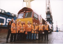 Left: The jubilant EWS Class 66 commissioning team stand in front of the locomotive, from left to right are: Mike Studley, Dave Phillips, Steve Faulkner, Tim Ware, Doug Roffey, Graham Preston, Ian Dougherty, Roland Hatton, Dave Shillitoe and Dave Wass. MEL HOLLEY.