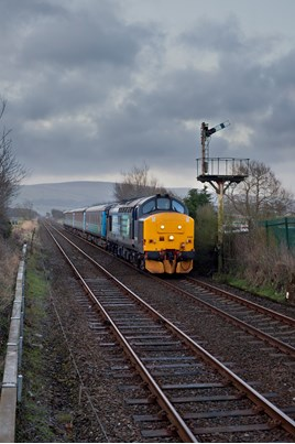 Direct Rail Services 37425 Sir Robert McAlpine/Concrete Bob passes Foxfield on the Cumbrian Coast on March 25, with the 0546 Barrow-in-Furness-Carlisle. ROBERT FRANCE.