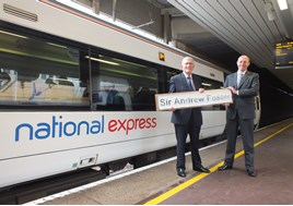 Sir Andrew Foster (left) and Dean Finch (right) stand with 357007 at London Fenchurch Street.